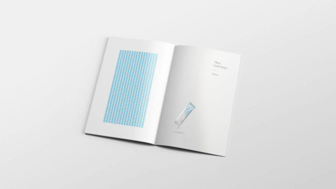 Grafisk design. En åpnet brosjyre med 07 profil inni. Illustrasjonsbilde.