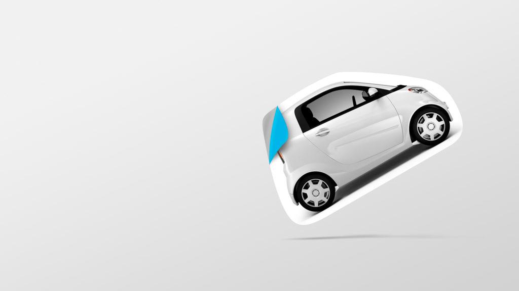 En utskjært bil hvor kanten brettes opp som på et klistremerke. Foto.