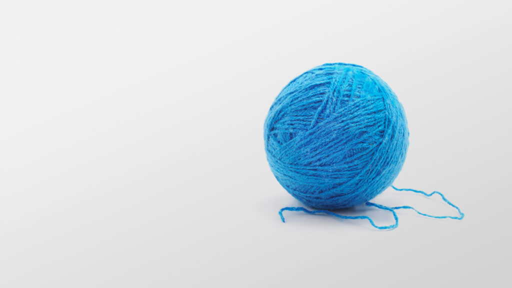 Et blått garnnøste. Illustrasjon.